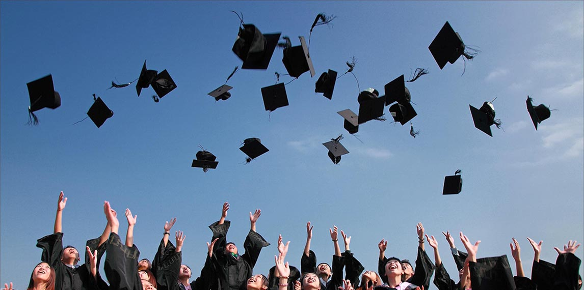 Mortar boards thrown in air