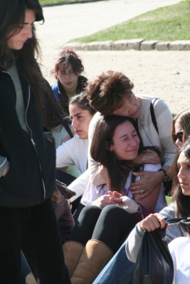 Sidonia Lax comforting student on BJE March of the Living