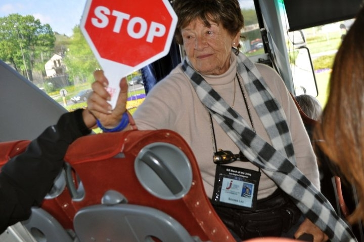 Sidonia Lax holding stop sign on March of the Living