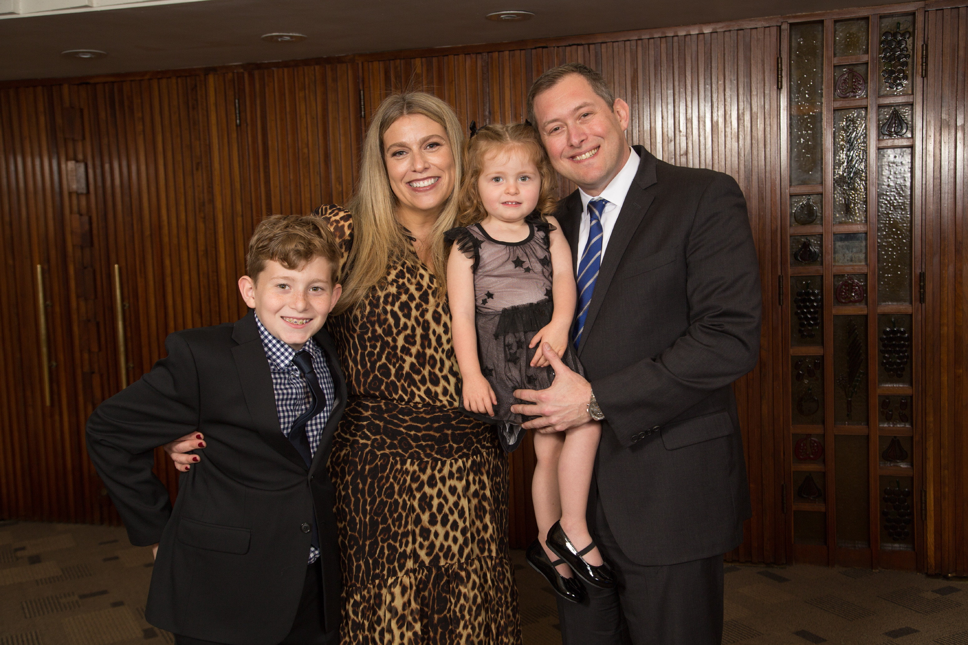 Honoree Craig Rutenberg with his wife Stephanie and their children