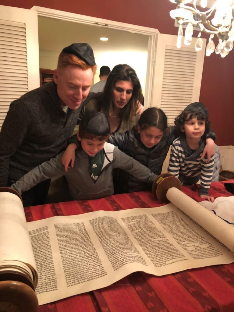 Simai Temple teacher showing younger children the Torah