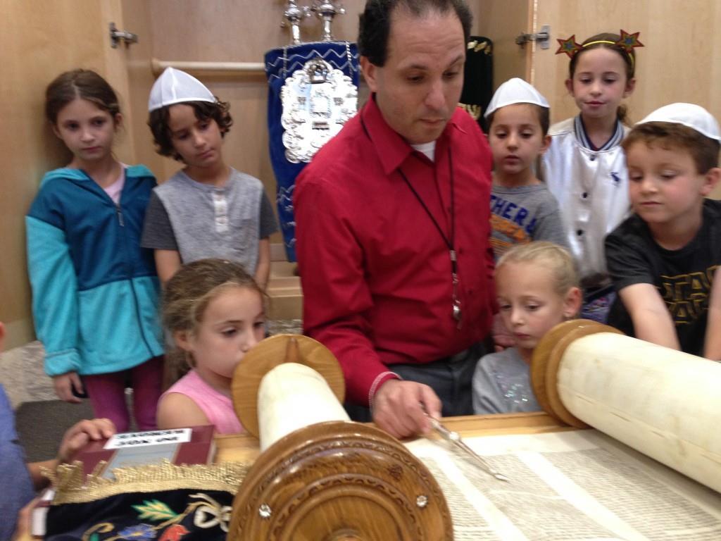 Temple Aliyah Religious school viewing Torah